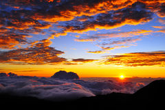 Sunset and cloudscape. Scenic view of colorful sunset and cloudscape viewed from summit of Haleakala volcano, Maui, Hawaiian Islands Stock Photo
