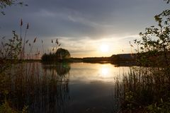 Sunset. Cloudy lake durring sunset, Lake Skoki, Poland Stock Photos