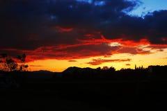 Sunset, cloudy sky background over night city. Nature. Stock Photos