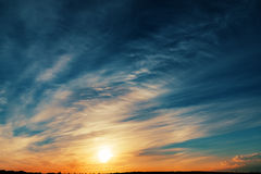 Sunset in cloudy sky Royalty Free Stock Image