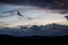 Sunset on cloudy sky Royalty Free Stock Photos