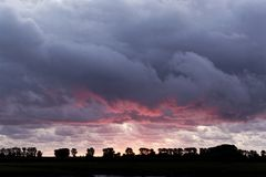 Sunset with a cloudy sky. In the Normandy in France Stock Photos