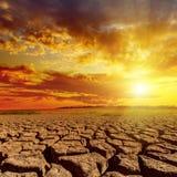 Sunset in cloudy sky over desert Stock Image