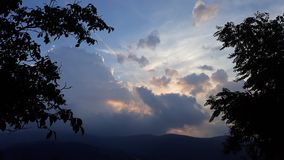 Sunset on cloudy sky. Picture of sunset on cloudy sky royalty free stock photos