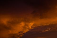 Sunset cloudy sky similar to raging sea Royalty Free Stock Image