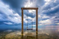 Apocalypse. Wooden swing in the sea, Gili Trawangan, Lombok, Ind stock photos
