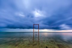 Apocalypse. Wooden swing in the sea, Gili Trawangan, Lombok, Ind royalty free stock image