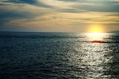 Sunset at coast stock photography