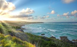 Sunset Coast in Barbados. Sunset at the east coast of Barbados with rugged coastline Stock Photo