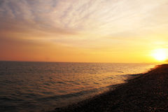 Sunset on the coast. Beautiful summer sunset at the seaside Royalty Free Stock Images