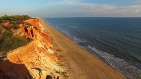 Sunset at coast cliffs beach aerial Portugal Algarve aerial view stock footage
