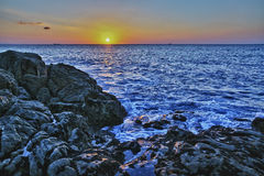 Sunset on the coast. Royalty Free Stock Photos