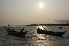 Sunset on the coast of Kampo. Kampot, Cambodia. Sunset on the coast of Kampot with silhouette of fishing boats, Cambodia Stock Photo
