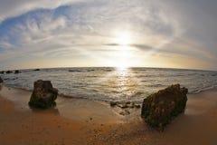 The sunset on coast of Mediterranean sea Stock Photos