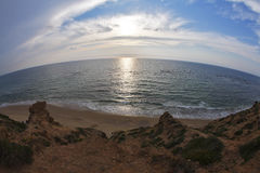 The sunset on coast of Mediterranean sea Royalty Free Stock Images