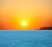 Sunset at coast of the Sea Stock Image