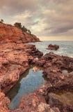 Sunset on the coast the village of Perello, Tarragona, Spain Royalty Free Stock Photo