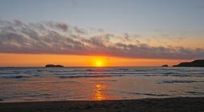 Sunset through Coastal Clouds Stock Photo
