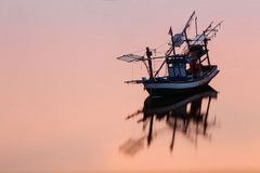 Sunset Coastal fisheries boat in Thailand Royalty Free Stock Photography