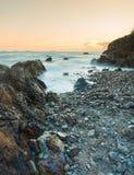 Sunset coastal with rock stone Stock Image