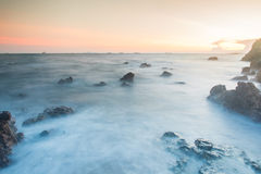 Sunset coastal with rock stone Royalty Free Stock Photography