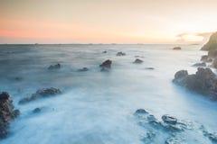 Sunset coastal with rock stone Royalty Free Stock Photography