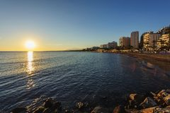 Sunset coastline at Costa del Sol beach in Marbella town, Andalusia, Spain Royalty Free Stock Photo
