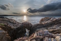 Sunset on the coasts of asturias, spain!. Sunset on the coasts of asturias, spain, semi-hidden the sun among the clouds playing with the natural and beautiful royalty free stock photo