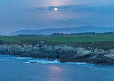 Sunset on the coasts of Galicia, spain!. Sunset on the coasts of Galicia, spain, semi-hidden the sun among the clouds playing with the natural and beautiful stock image