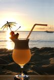 Sunset cocktail. Relax concept, social drinking in beach setting royalty free stock images