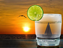 Sunset cocktail with sailboat Royalty Free Stock Photography
