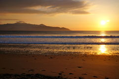 Brandon Bay sunset with mountain on background. Sunset on a cold spring day Stock Photo