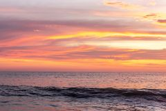 Sunset color of clouds above sea water stock photos