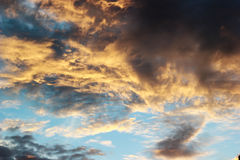 Sunset with color gradient nimbus clouds stock photo