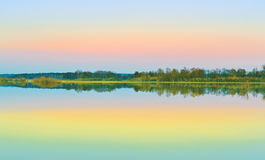 Sunset. Colorful sunset mirrored in spring flood Stock Images
