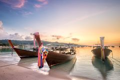 Sunset with colorful sky and boat on the beach Stock Image