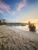 Sunset with colorful sky and boat on the beach Royalty Free Stock Images