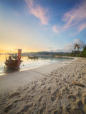 Sunset with colorful sky and boat on the beach Royalty Free Stock Photo