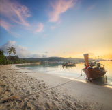Sunset with colorful sky and boat on the beach Royalty Free Stock Photography