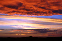 Sunset of colors. With hills in the distance Stock Photography