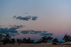Dusk colors in the sky at twilight on a mine site in Lightning Ridge Australia royalty free stock photo