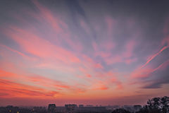 Precious sunset violet shades colors. Beautiful sunset violet shades of colors of sky and clouds in the city of Milan, Italy royalty free stock photos