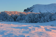 Sunset colors at mountain plateau in winter. Royalty Free Stock Photography