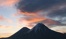 Sunset colors over volcanoes stock photos
