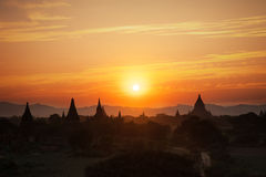 Sunset colors and silhouettes of ancient Buddhist Temples. Myanmar Royalty Free Stock Image