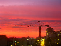 Sunset at the construction site. Beautiful red sunset over the construction site Stock Photo