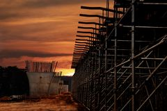 Sunset at the construction site royalty free stock photos