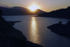 Sunset and contre on the Charvak reservoir Stock Image