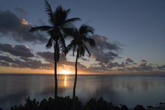 Sunset in the Cook Islands in the South Pacific. Sunset over a tropical lagoon in Aitutaki in the Cook Islands in the South Pacific royalty free stock photos