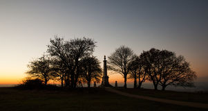 Sunset at Coombe Hill Memorial in the Chiltern Hills. Golden sunset at the Coombe Hill Memorial in the Chiltern Hills, Buckinghamshire, United Kingdom looking Stock Photography
